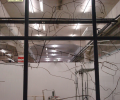 06 RADIOGRAFIA -Exploração para a Construção de um Retrato Sonoro / Guimarâes 2012 - Fábrica Asa - Intalação Dimensões variáveis- Tinta da china sobre vidro